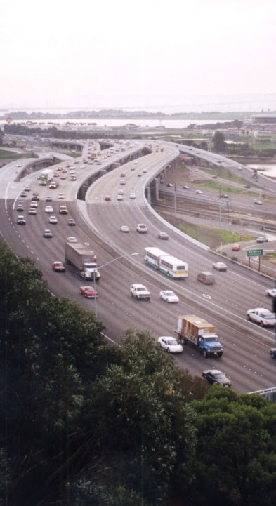 A photo showing the view over a noisy freeway from a condominium.